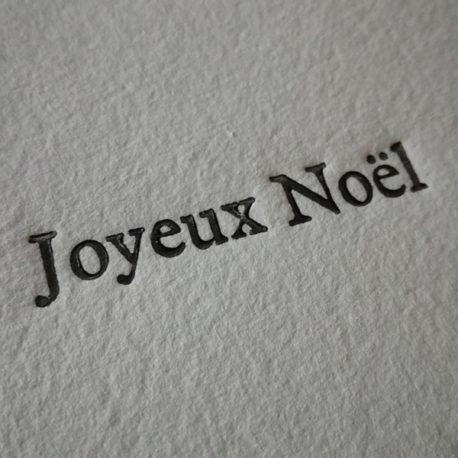 Carte typographiée «Joyeux Noël» sur papier fait main